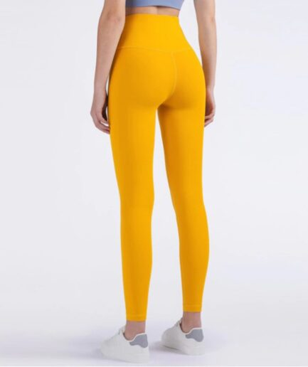 Comfortable Running And Formfitting Yoga Pants For Women in yellow color